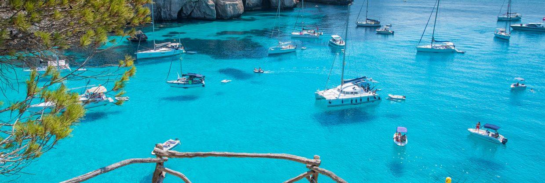 Španělsko: ostrov Menorca z Vídně v červnu a červenci